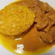 Oranges Menue Kürbisotto mit Schweinefiet